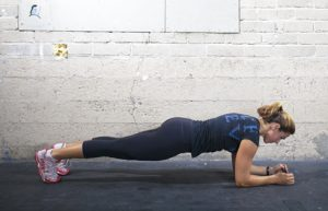 Jessica Law demonstrates a plank East Village Crossfit in San Diego.